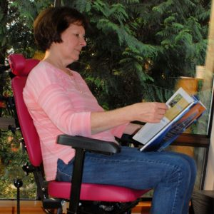 woman reading in chair