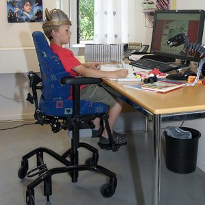 child in REAL chair at desk
