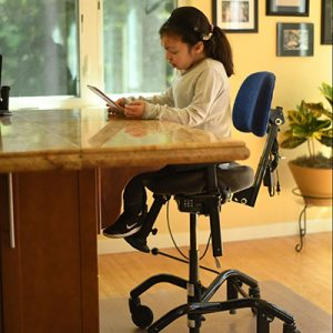 young girl studying in chair